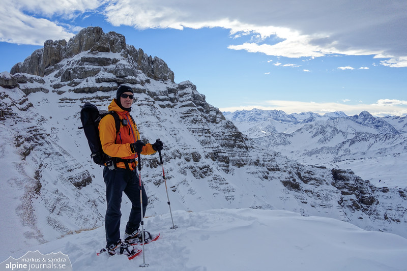 """A late december snow shoe walk beyond Hahnenköpfle. Markus poses in front of the west face of Hohe Ifen. You will find photos of the west face in the """"Alps in winter"""" album."""
