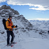 "A late december snow shoe walk beyond Hahnenköpfle. Markus poses in front of the west face of Hohe Ifen. You will find photos of the west face in the ""Alps in winter"" album."