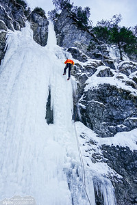 Markus abseiling from the middle route of Schwarze Wand, Tannheim.