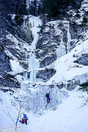The left-most and middle waterfalls of Schwarze Wand in Tannheim (both routes around WI3-4, possibly brief sections slightly more, and a warmup WI2-3 furthest down).