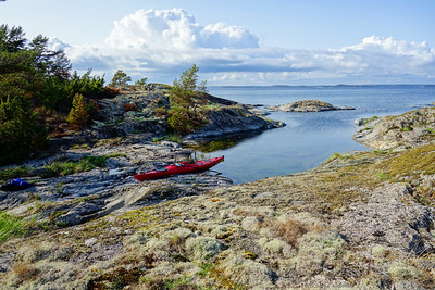 A solitary kayak resting on the rock.
