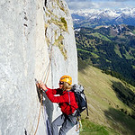 Markus dancing along the aid traverse of Diehlkante, Dent de Ruth. We have a few old memory scars from blank traverses, and didn't look forward to thin one. Imagine, then, after a long day o ...