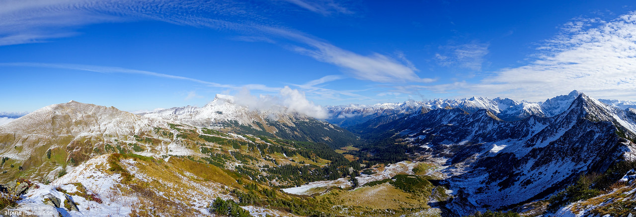 This panorama includes Hählekopf, Hohe Ifen in clouds, and the ridge we have gone along - from its beginning (mid picture) to Grünhorn (right). We are about to descend the smooth Steinmandl ridge starting at the bottom left, toward Schwarzwasser hut.