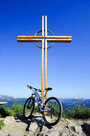 New fancy summit cross adored with a just as fancy bike, at Kuhgehrenspitze.
