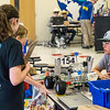 Teams also share their robotics experiences with visitors in the pit area.