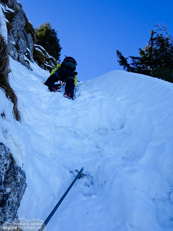 Two parts of the ferrata are covered in snow. Since a fall would be fatal, we procede with care, using the ski poles (without the snow plates) for better balance. The snow is firm and provides good foothold.