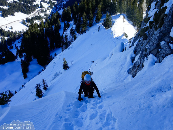 An exposed (un-belayed) section of the Besler ferrata. Steep, but the snow is good.