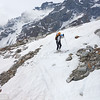 Descent to Mezzalama hut, snow is melting away and the rocks are peaking out.