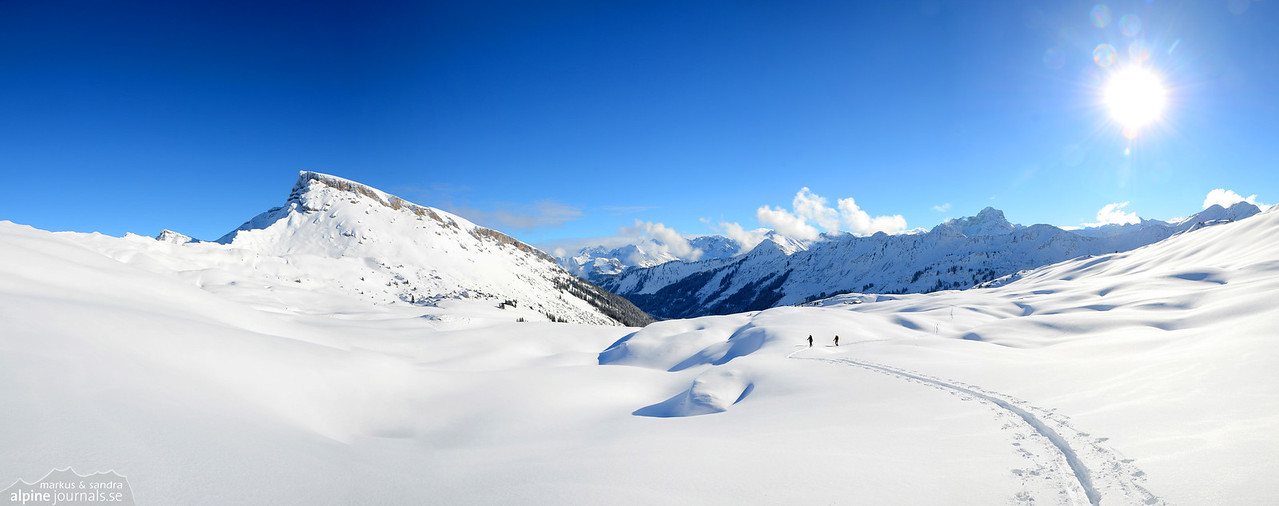Two tourers following our fresh tracks in the snow. Hohe Ifen to the left.