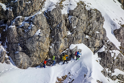 A group starts their ascent of M. Schafalpkopf along the Mindelheimer ferrata. Of course, oversnowed cables is to be expected. It is an exposed undertaking for experienced climbers.