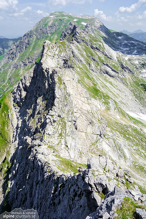 On Hindelanger Klettersteig, still a long way from the green wide summit of Grosse Daumen. Just to the right of this photo is a descent by yet another ladder.
