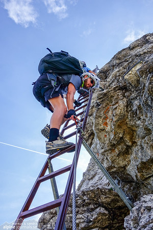 Climbing up the first ladder of Hindelanger Klettersteig.