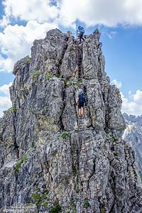 Descending another long ladder at the last section of Hindelanger Klettersteig.