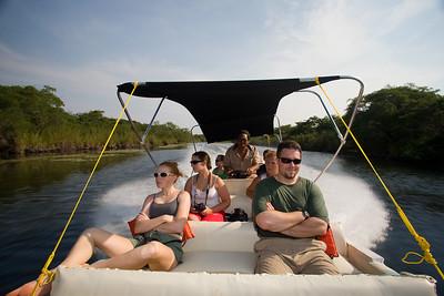 Tourist on Lamanai tour making their way via the river.