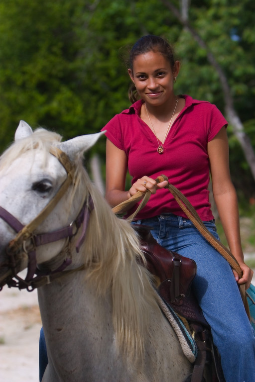 Young girl on horseback in Silk Grass, Stann Creek, Belize.