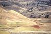 Winter bike tourer on dirt road in Oregon's John Day Fossil Beds Nat'l Monument - 72 ppi 6