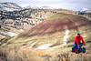 Winter bike tourer on dirt road in Oregon's John Day Fossil Beds Nat'l Monument - 72 ppi 12