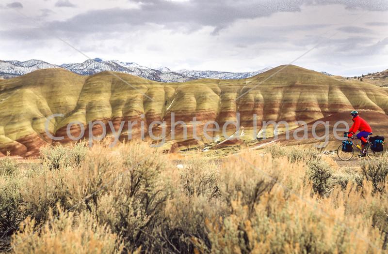 Winter bike tourer on dirt road in Oregon's John Day Fossil Beds Nat'l Monument - 72 ppi 13