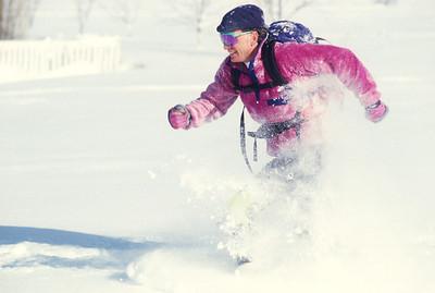 SN ut wstc 5 - ORps - jpeg - Snowshoer running in Utah's Wasatch Mountains near Salt Lake City