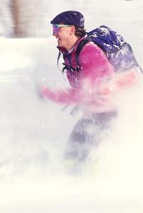 SN ut wstc 3 - ORps - jpeg - Snowshoer running in Utah's Wasatch Mountains near Salt Lake City