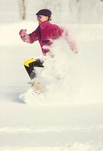 SN ut wstc 4 - ORps - jpeg - Snowshoer running in Utah's Wasatch Mountains near Salt Lake City