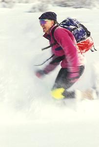 SN ut wstc 2 - ORps - jpeg - Snowshoer running in Utah's Wasatch Mountains near Salt Lake City
