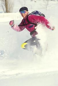 SN ut wstc 1 - ORps - jpeg - Snowshoer running in Utah's Wasatch Mountains near Salt Lake City