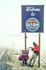 Touring cyclist on Utah-Wyoming border - winter Rockies ride - 72 ppi
