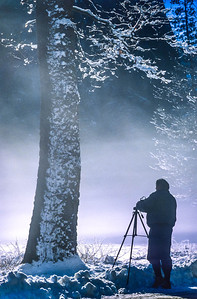 Photographer in Yosemite NP setting up a shot - 72 ppi