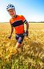 ACA - TransAm rider in wheat field near Coyville, Kansas - C2-0123 - 72 ppi - 2