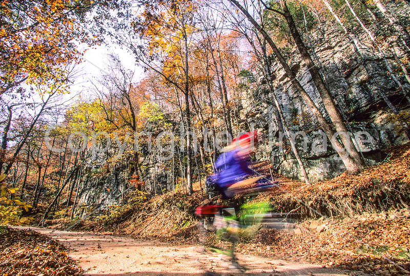 Cyclist on Cave Mountain Road (County Road 5) on Upper Buffalo Wilderness Loop in northwest Arkansas - 5 - 72 ppi