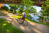 Cyclist on flooded waterfront of Little Rock, Arkansas; south end of Junction Bridge - _1C30017 - 72 ppi