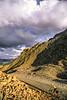 Biker at Ophir Pass on Colorado's Alpine Loop, between Silverton & Telluride - 3 - 72 ppi