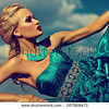 stock-photo-high-fashion-look-beautiful-sexy-stylish-blond-young-woman-model-with-bright-makeup-red-lips-with-207908473