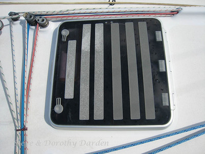 Crew cabin hatch, newly applied 3M grey nonskid. This is all 3M grey, not clear - we used the remaining 2 rolls of grey in our inventory. When we applied the tape the grey color was identical for all the strips. Oddly, the 3 strips from one roll seem to have changed color.