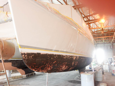 Bottom paint prep, port hull. After Matthew scraped and sanded all the questionable antifoul.