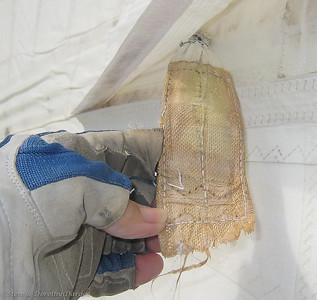 Lower batten pocket shows just two rows of zig zag stitching holding the webbing to the sail.