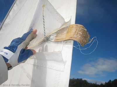 Lower batten pocket. You can see the broken threads where the stitching come away from the sail.