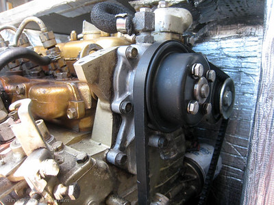 Genset coolant pump showing bleed valve connection