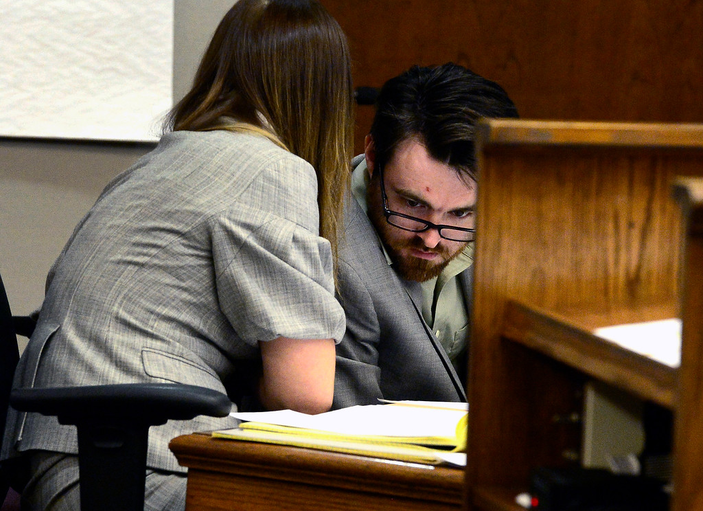. Adam Densmore talks to his attorney Kathryn Herold on Monday afternoon in the Boulder County Justice Center during Densmore\'s trial were he is accused of murdering his ex-girlfriend, Ashley Mead.  Paul Aiken/ Staff Photographer April 16, 2018