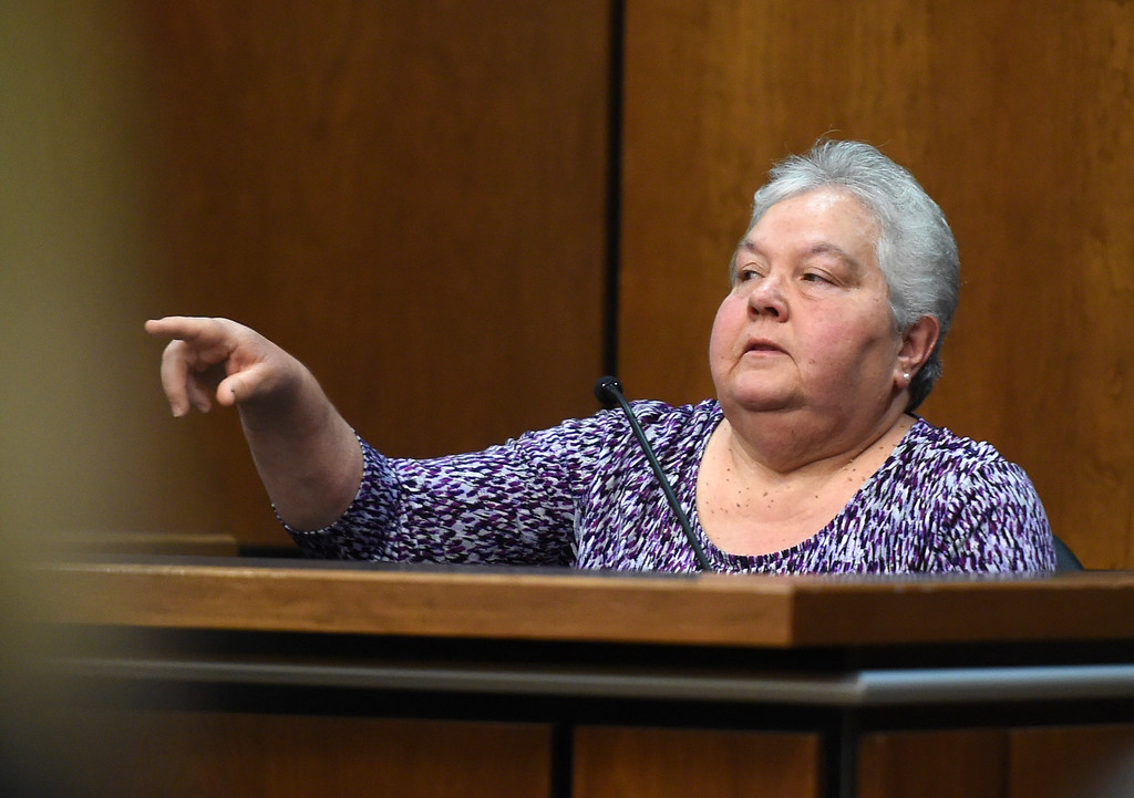 . Witness, Debbie Bethurum, points out Adam Densmore in the courtroom. Attorneys made their opening statements Thursday morning to a jury of 16 people � nine men and seven women � who will hear testimony over the next three weeks to determine if Adam Densmore is guilty of killing and dismembering his ex-girlfriend, Boulder\'s Ashley Mead. Densmore, 33, is charged with first-degree murder, tampering with a corpse, abuse of a corpse and tampering with physical evidence. Cliff Grassmick  Photographer  April 12, 2018