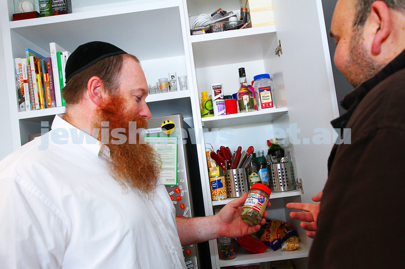 August 2014. Adam Ruschinek checking for kosher products in a pantry. Photo: Peter Haskin