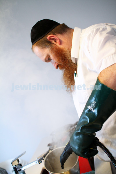 August 2014. Mashgiach Adam Ruschinek koshering a kitchen. Photo: Peter Haskin