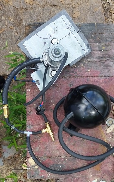 """This is what you need to fix a low vacuum condition to give about 20"""" Hg vacuum for power brakes to be effective. My idling vacuum is 12.5"""", and the power brakes still required a fair amount of pressure to stop the car .......Upper left is a GM style vacuum pump with the suction port connected to a check valve then to a tee that branches off to a vacuum reservoir, then to another tee with one port going to a vacuum control switch and the other port going to the power brake diaphragm. The discharge port from the vacuum pump (smaller line on the pump) should tie into the original connection on the carburetor. Made a mounting plate to put it near the firewall on passenger side """"under edge of fender"""". Painted black after this pic. As an additional note, a power brake booster is a safety issue that should not be ignored. Think of what happens if for some crazy reason your engine dies while you are going kinda fast or approaching an intersection."""