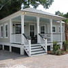 The South Bay Cottage by Allison Ramsey Architects built on Duke Street in Downtown Beaufort, South Carolina. This plan is 1022 Heated Square Feet, 2 Bedrooms and 1 1/2 Bathrooms.