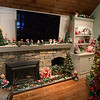 Annalee Christmas dolls and gnomes adorn the fireplace.