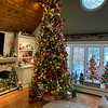 A towering, 12-foot tree is the focal point of the family room, which is loaded with Christmas spirit.