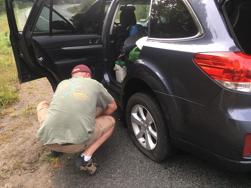 changing a flat near Indian Lake en route to Old Forge