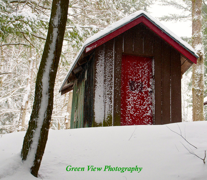 Snow coated cabin on White Lake