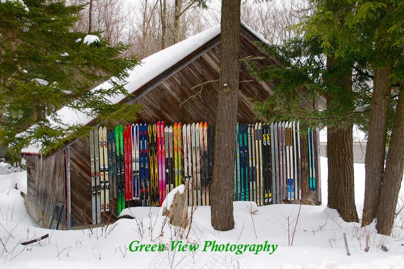 Colorful skiis on Barn